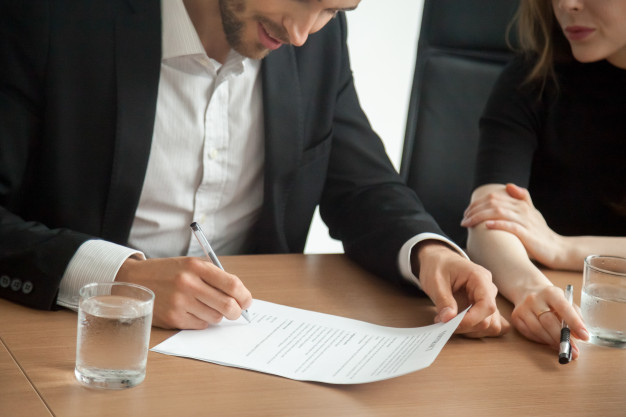 Satisfied Smiling Businessman Suit Signing Contract Meeting Concept 1163 4653